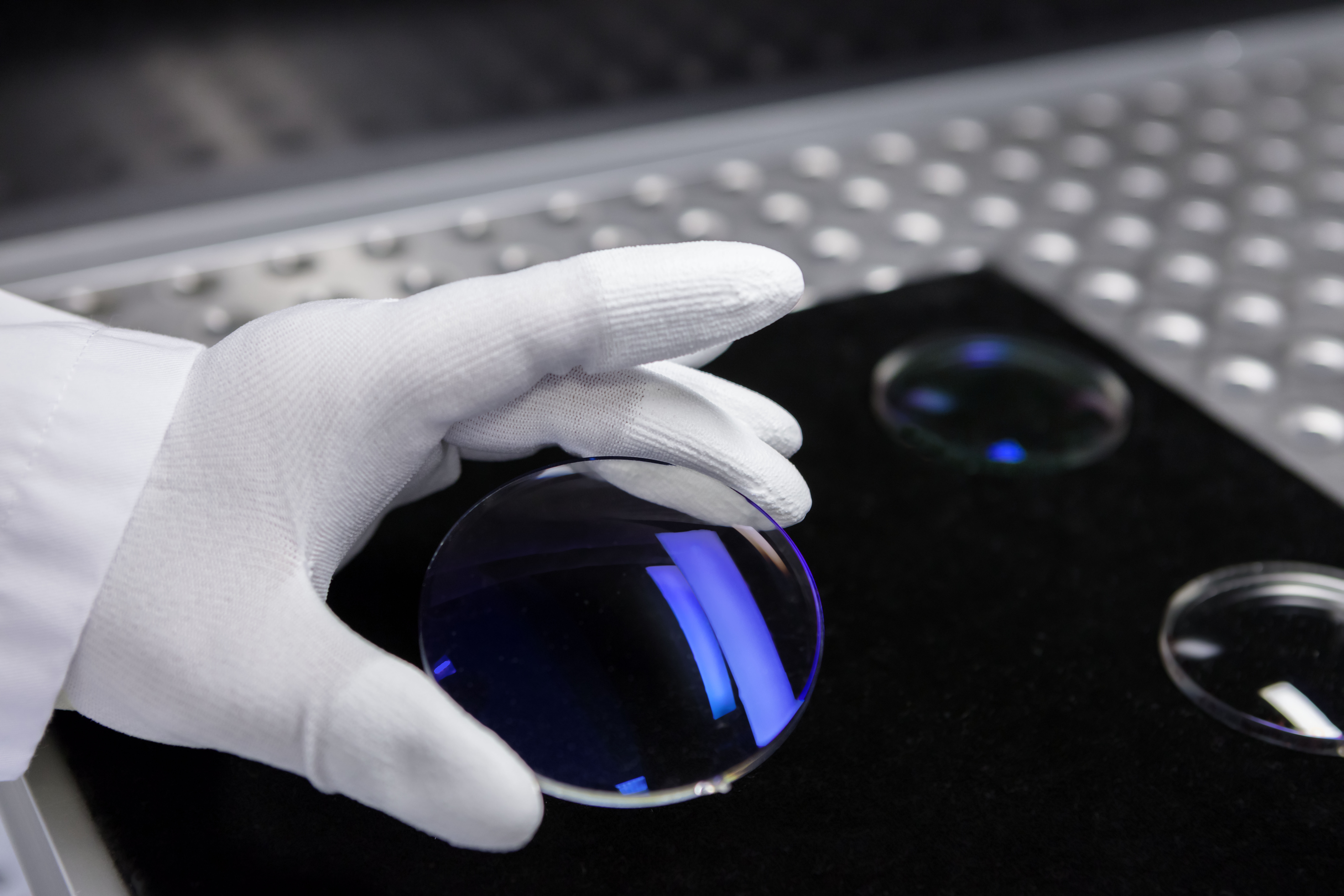 The blue reflex color of the ZEISS lenses is a unique characteristic made with Bühler coating technology.