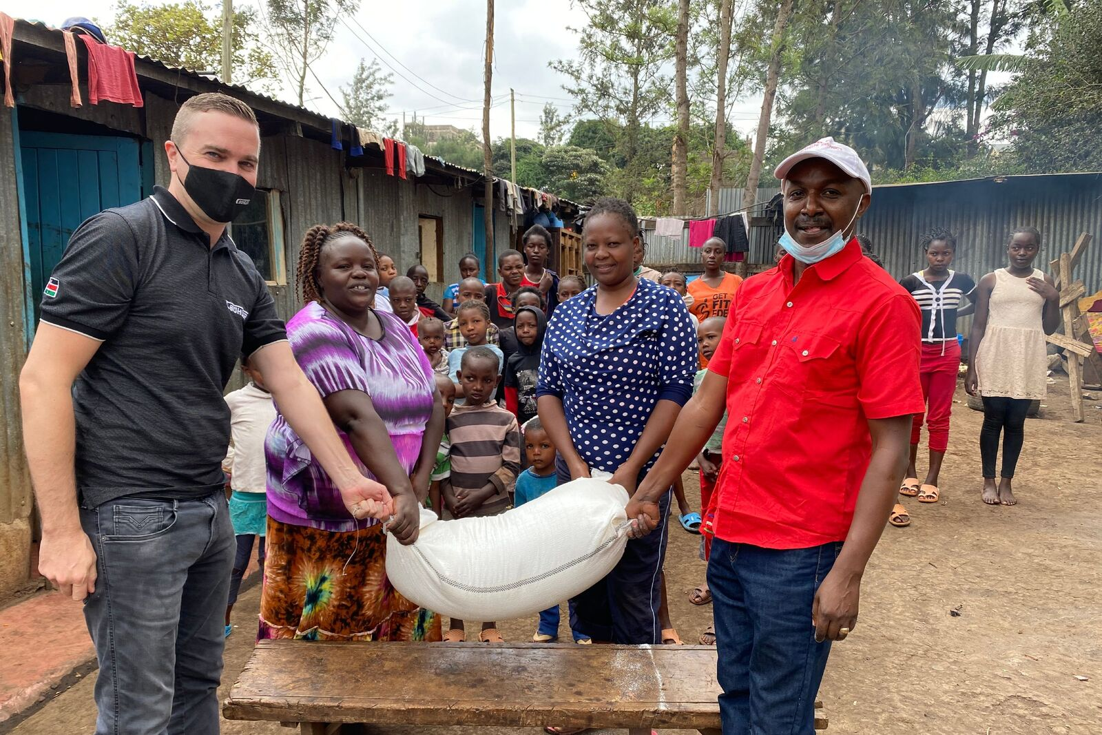 Stefan Lutz, Head of the African Milling School, donates fortified maize flour to the children's homes.