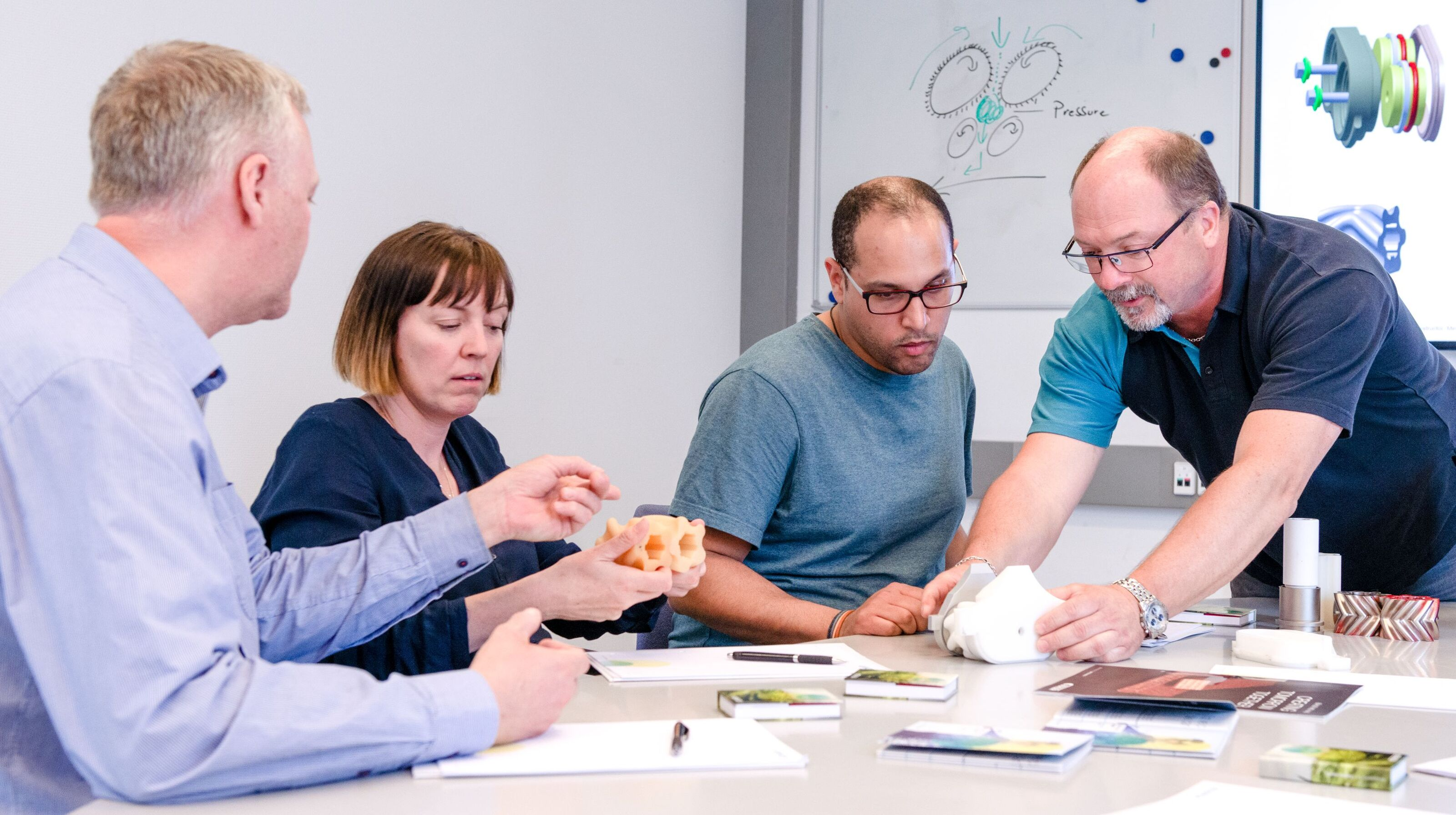 Bühler expert training customers in a well-equipped classroom.