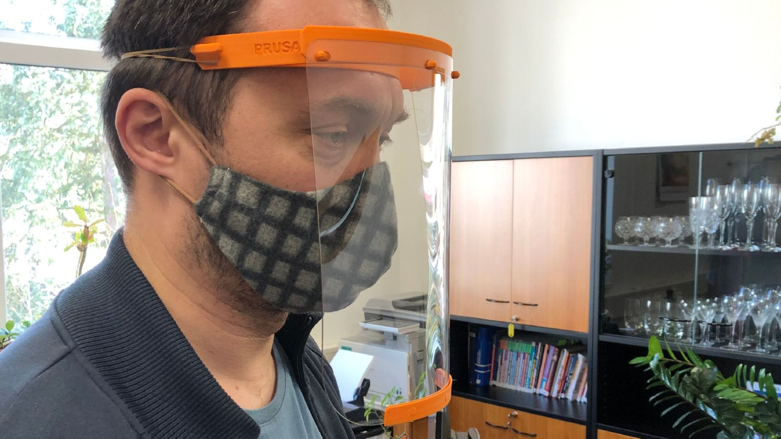 Bühler employee wearing a 3D printed face shield.